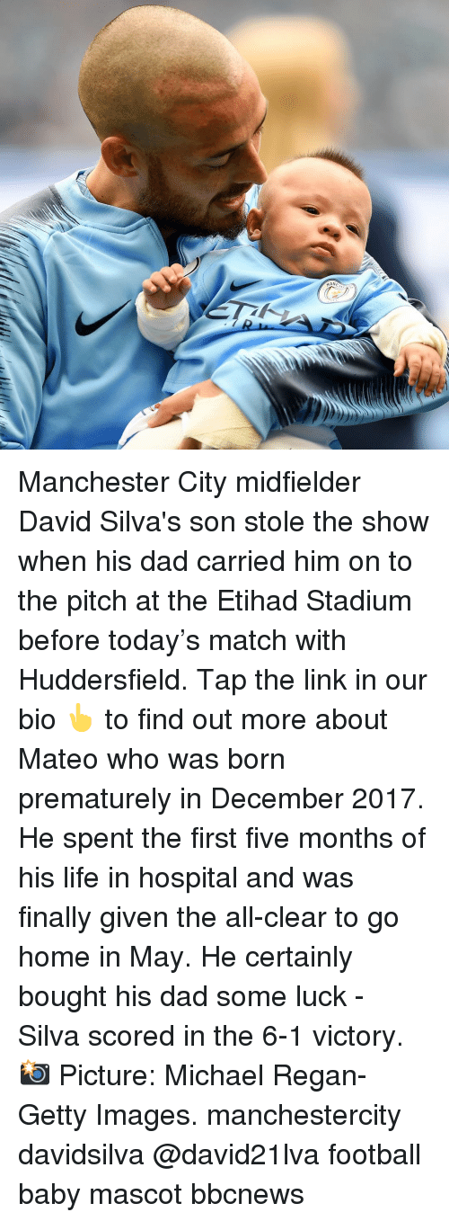 stole the show: Manchester City midfielder David Silva's son stole the show when his dad carried him on to the pitch at the Etihad Stadium before today's match with Huddersfield. Tap the link in our bio 👆 to find out more about Mateo who was born prematurely in December 2017. He spent the first five months of his life in hospital and was finally given the all-clear to go home in May. He certainly bought his dad some luck - Silva scored in the 6-1 victory. 📸 Picture: Michael Regan-Getty Images. manchestercity davidsilva @david21lva football baby mascot bbcnews