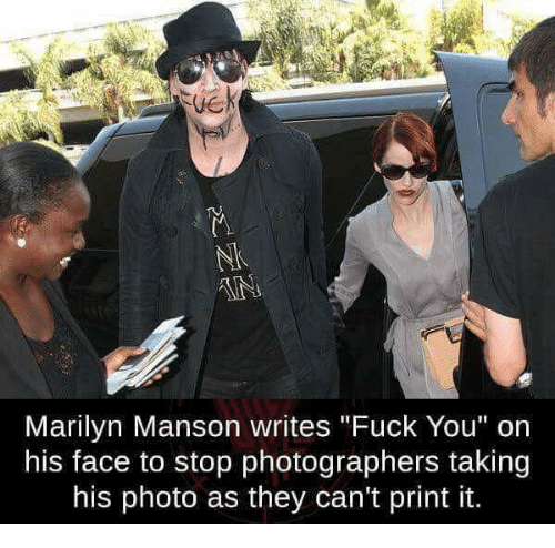 """Fuck You, Marilyn Manson, and Fuck: Marilyn Manson writes """"Fuck You"""" on  his face to stop photographers taking  his photo as they can't print it."""