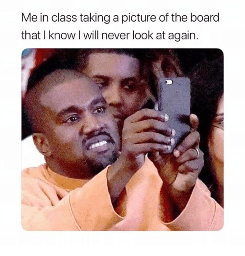 Taking A Picture: Me in class taking a picture of the board  that I know l will never look at again.