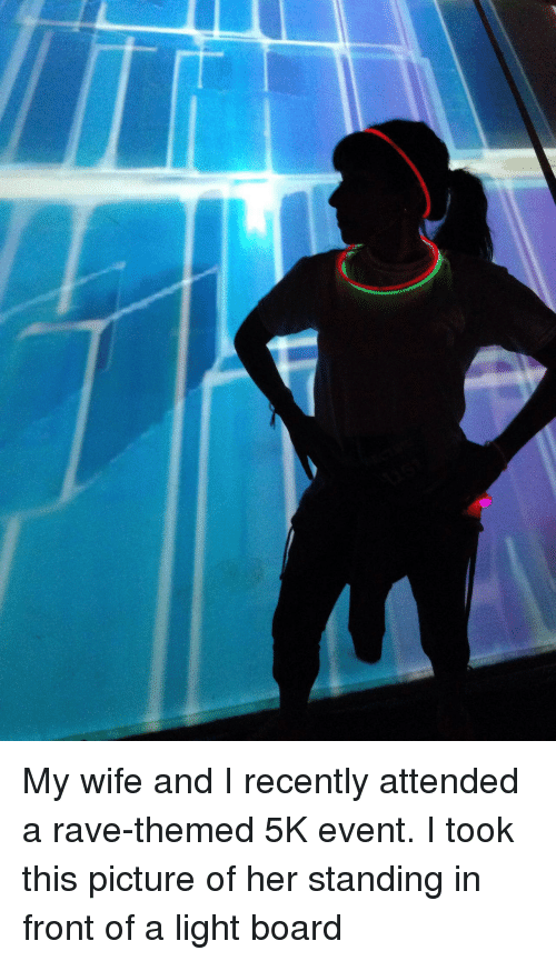 Rave: My wife and I recently attended a rave-themed 5K event. I took this picture of her standing in front of a light board