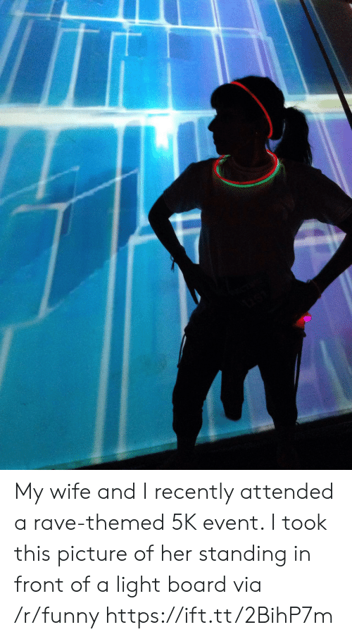 Rave: My wife and I recently attended a rave-themed 5K event. I took this picture of her standing in front of a light board via /r/funny https://ift.tt/2BihP7m