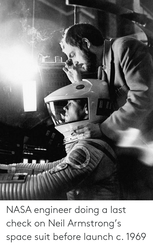 Neil: NASA engineer doing a last check on Neil Armstrong's space suit before launch c. 1969