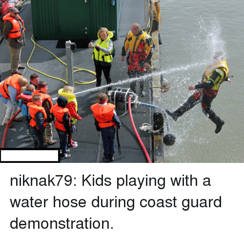 Coast Guard: niknak79:  Kids playing with a water hose during coast guard demonstration.