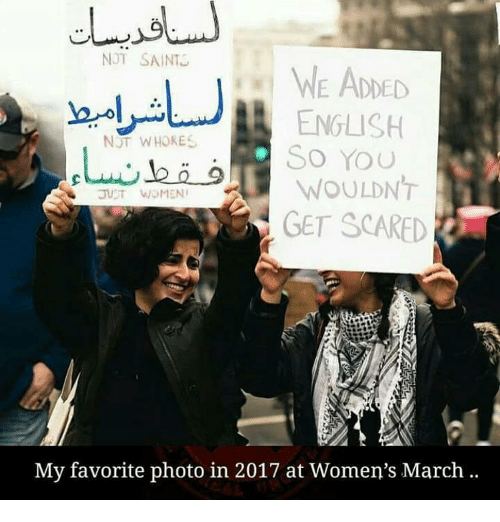 Women March: NOT SAINT  WE ADDED  ENGLISH  NOT WHORES  So You  WOULDNT  GET SCARED  My favorite photo in 2017 at Women's March.