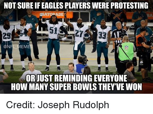 NFL: NOT SURE IF EAGLES PLAYERS WERE PROTESTING  ERATO ADE  33  28  @NI  EM  OR JUST REMINDING EVERYONE  HOW MANY SUPER BOWLS THEY'VE WON Credit: Joseph Rudolph