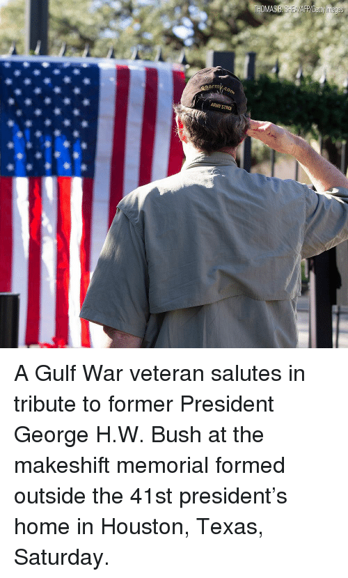 Memorial: oarm A Gulf War veteran salutes in tribute to former President George H.W. Bush at the makeshift memorial formed outside the 41st president's home in Houston, Texas, Saturday.