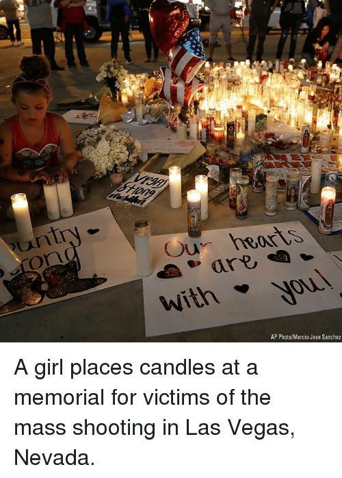 Memes, Las Vegas, and Girl: Our heorS  withyou  AP Photo/Marcio Jose Sanchez A girl places candles at a memorial for victims of the mass shooting in Las Vegas, Nevada.