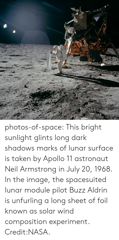 lunar: photos-of-space:  This bright sunlight glints  long dark shadows marks of lunar surface is taken by Apollo 11 astronaut Neil Armstrong in July 20, 1968. In the image, the spacesuited lunar module pilot Buzz Aldrin is unfurling a long sheet of foil known as solar wind composition experiment. Credit:NASA.