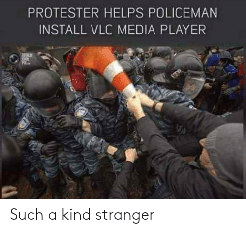 Protester: PROTESTER HELPS POLICEMAN  INSTALL VLC MEDIA PLAYER Such a kind stranger