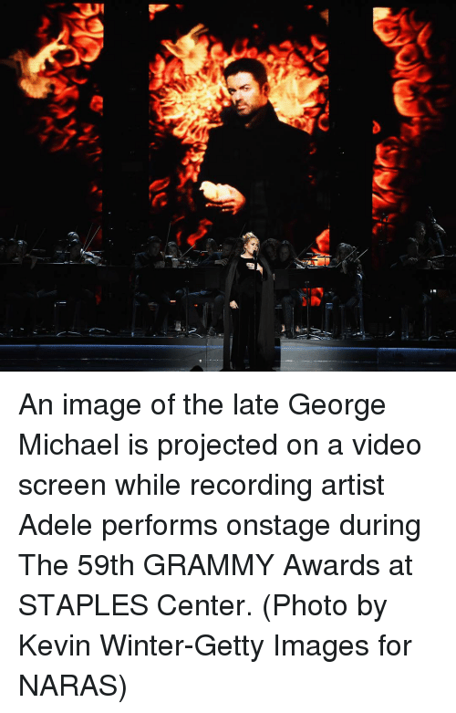 Staples Center: re An image of the late George Michael is projected on a video screen while recording artist Adele performs onstage during The 59th GRAMMY Awards at STAPLES Center. (Photo by Kevin Winter-Getty Images for NARAS)