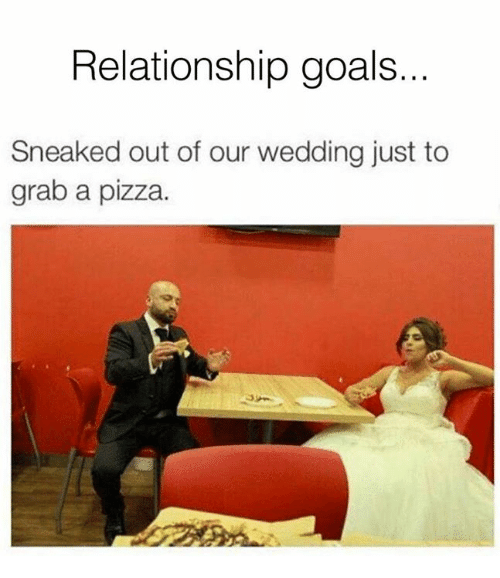 Dank, Goals, and Pizza: Relationship goals.  Sneaked out of our wedding just to  grab a pizza.