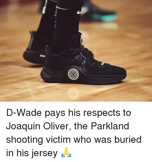 d wade: sal D-Wade pays his respects to Joaquin Oliver, the Parkland shooting victim who was buried in his jersey 🙏