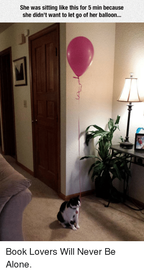 Book Lovers: She was sitting like this for 5 min because  she didn't want to let go of her balloon... <p>Book Lovers Will Never Be Alone.</p>