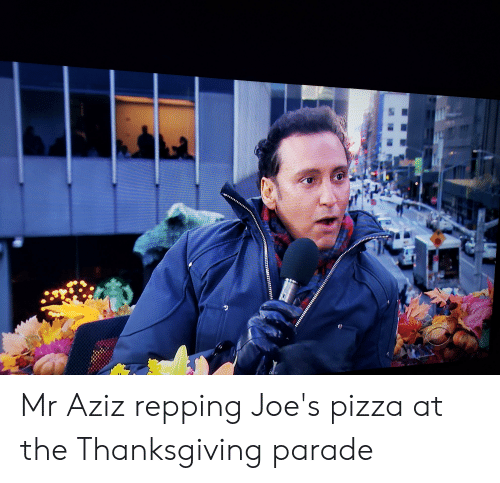 repping: SNT Mr Aziz repping Joe's pizza at the Thanksgiving parade