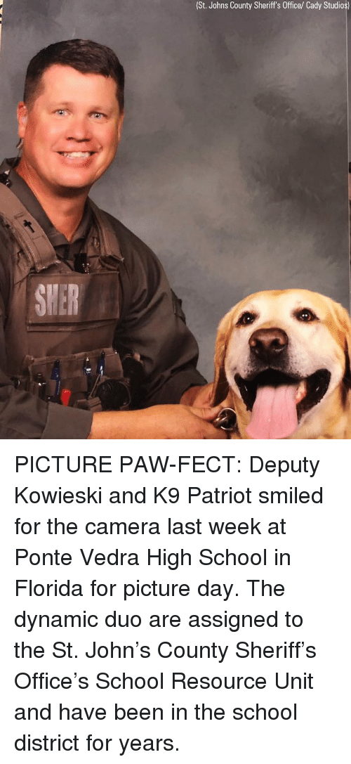 patriot: (St. Johns County Sheriff's Office/ Cady Studios) PICTURE PAW-FECT: Deputy Kowieski and K9 Patriot smiled for the camera last week at Ponte Vedra High School in Florida for picture day. The dynamic duo are assigned to the St. John's County Sheriff's Office's School Resource Unit and have been in the school district for years.