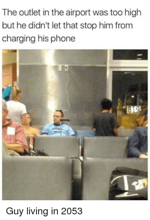 Outlet: The outlet in the airport was too high  but he didn't let that stop him from  charging his phone Guy living in 2053