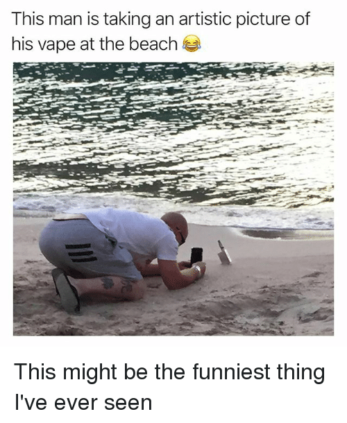 Funny, Vape, and Beach: This man is taking an artistic picture of  his vape at the beach This might be the funniest thing I've ever seen