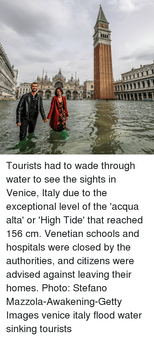 exceptional: Tourists had to wade through water to see the sights in Venice, Italy due to the exceptional level of the 'acqua alta' or 'High Tide' that reached 156 cm. Venetian schools and hospitals were closed by the authorities, and citizens were advised against leaving their homes. Photo: Stefano Mazzola-Awakening-Getty Images venice italy flood water sinking tourists