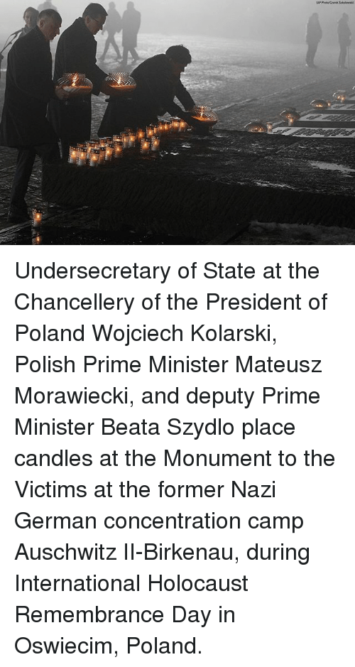 concentration camp: Undersecretary of State at the Chancellery of the President of Poland Wojciech Kolarski, Polish Prime Minister Mateusz Morawiecki, and deputy Prime Minister Beata Szydlo place candles at the Monument to the Victims at the former Nazi German concentration camp Auschwitz II-Birkenau, during International Holocaust Remembrance Day in Oswiecim, Poland.