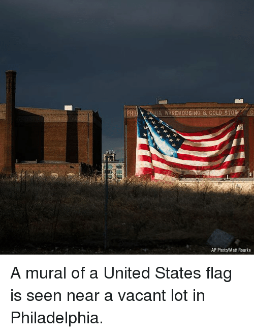 Memes, Philadelphia, and United: WAREHOUSING&COLD STORE  AP Photo/Matt Rourke A mural of a United States flag is seen near a vacant lot in Philadelphia.