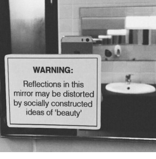 Reflections: WARNING:  Reflections in this  mirror may be distorted  by socially constructed  ideas of 'beauty'