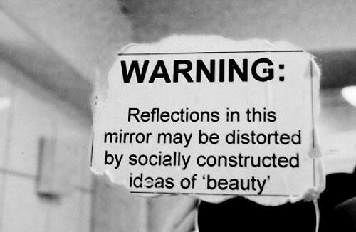 Reflections: WARNING:  Reflections in this  mirror may be distorted  by socially constructed  ideas of 'beaut