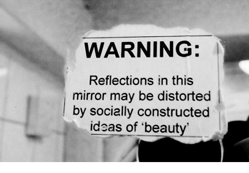 Reflections: WARNING:  Reflections in this  mirror may be distorted  lby socially constructed  ideas of 'beaut